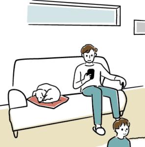 ソファに座る男性と犬